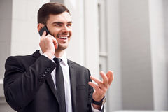Positive man talking on cell phone Royalty Free Stock Image