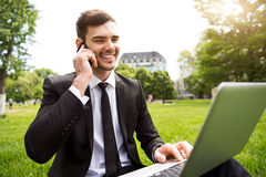 Positive man talking on cell phone Stock Image