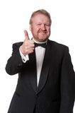Positive man in tuxedo gives thumbs up Stock Images