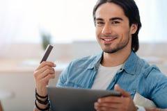 Positive man using tablet Stock Photos