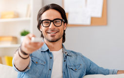 Positive man watching TV at home Stock Photography