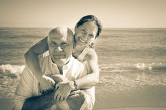 Positive mature couple. Portrait of mature couple against sea Royalty Free Stock Photo