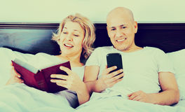 Positive  mature couple together social networking Royalty Free Stock Photo