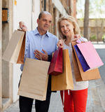 Positive mature family with bags after shopping Royalty Free Stock Images