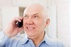 Positive mature man speaks by phone Royalty Free Stock Photo