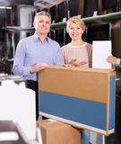 Positive mature married couple in shop packed household applianc Stock Photo