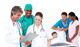Positive medical team taking care of a little boy Stock Photos