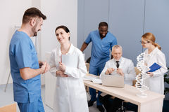 Positive medics enjoying science conference in the medical college Stock Image