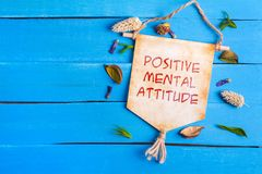 Positive mental attitude text on Paper Scroll stock photography