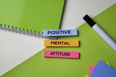 Positive Mental Attitude text on top view office desk table of Business workplace and business objects royalty free stock photo