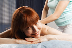 Positive redhead having a massage Stock Images