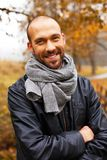 Positive middle-aged man on autumn day Stock Photos