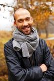 Positive middle-aged man on autumn day Stock Photos