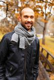 Positive middle-aged man on autumn day. Positive middle-aged man alone on beautiful autumn day Stock Images