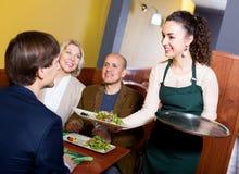 Positive middle class people enjoying food Stock Image