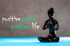 Positive mind - positive life. figurine of a meditating young girl. Lifestyle Positive Thoughts Mind Life Concept.  Royalty Free Stock Image