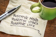 Positive mind, vibes and life. Positive mind, positive vibes, positive life - motivational handwriting on a napkin with a cup of coffee stock photography