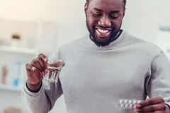 Positive Minded African American Man Taking Medication Royalty Free Stock Photography