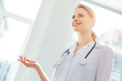 Positive minded blonde woman working in clinic and shining royalty free stock photos