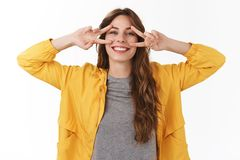 Positive minds healthy body. Bright lucky carefree gorgeous caucasian girl smiling broadly toothy grin show peace royalty free stock images