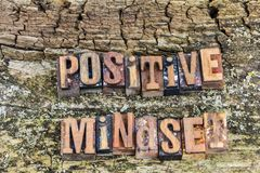 Positive mindset  succes concept letterpress. Positive mindset letterpress type successful attitude weathered wood background sign Royalty Free Stock Images