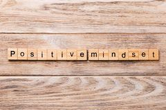Positive mindset word written on wood block. positive mindset text on wooden table for your desing, concept stock image