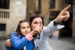 Positive mother pointing to daughter new sight Royalty Free Stock Images