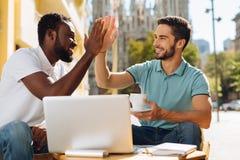 Positive motivated guys agreeing on something Stock Photo