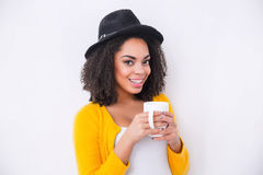 Positive mulatto woman drinking tea Royalty Free Stock Images