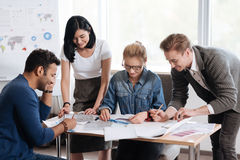 Free Positive Nice Colleagues Working Together Royalty Free Stock Photography - 92870537