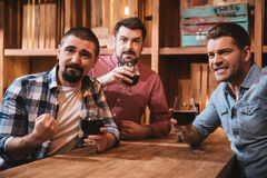 Positive nice men having an evening out Royalty Free Stock Photography