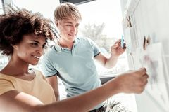 Positive nice people looking at the whiteboard royalty free stock images