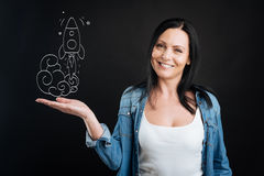 Positive nice woman looking at the rocket launch royalty free stock photography