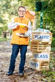 Positive nice young boy collecting dangerous waste royalty free stock photo