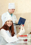 Positive nurse and  doctor  in clinic lab Stock Image