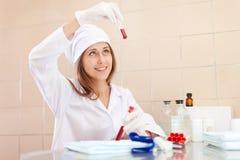 Positive  nurse in laboratory Royalty Free Stock Photo