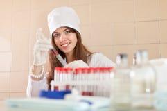 Positive nurse  in laboratory Stock Photography