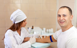 Nurse makes to man an injection Stock Photos