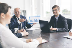 Positive office meeting at a massive table Royalty Free Stock Photography
