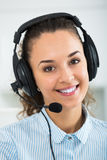 Positive operator working with client by headset Royalty Free Stock Photos