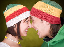 Positive pair in reggae hats that scream. Close up of positive pair in reggae hats that scream together stock photography
