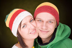 Positive pair in reggae hats smile together Royalty Free Stock Photo