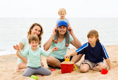 Positive parents with kids on vacation Royalty Free Stock Image
