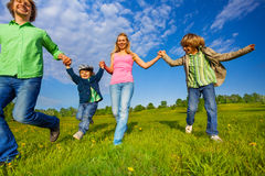 Positive parents walking with boys in park Royalty Free Stock Image