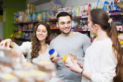 Positive people choosing tinned food Royalty Free Stock Image
