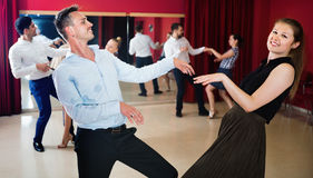 Positive people dancing twist in pairs. Young happy  positive people dancing twist in pairs Stock Photos