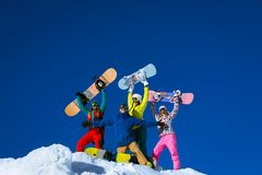 Positive people. Happy people with snowboards outdoors Royalty Free Stock Image