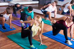 Positive people practicing yoga Royalty Free Stock Photos