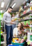 Positive people selecting juice Stock Photo