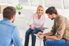 Positive people solving some problems Stock Photo